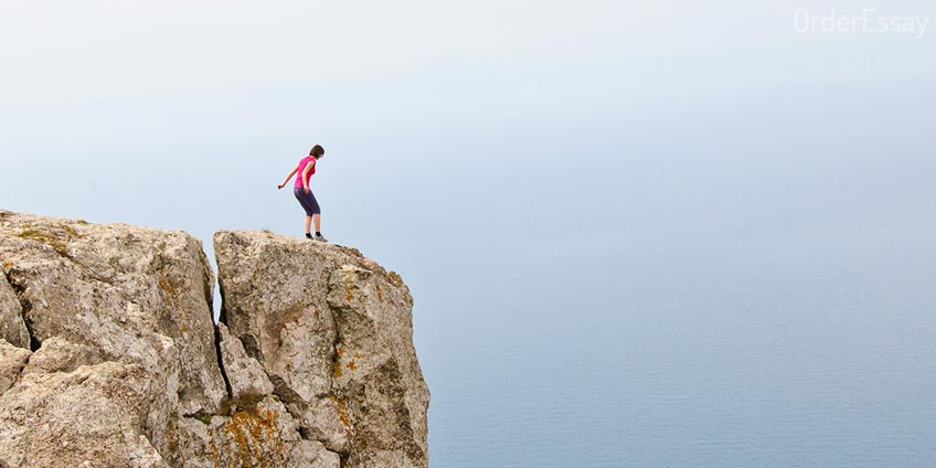 Man Making Step from Cliff