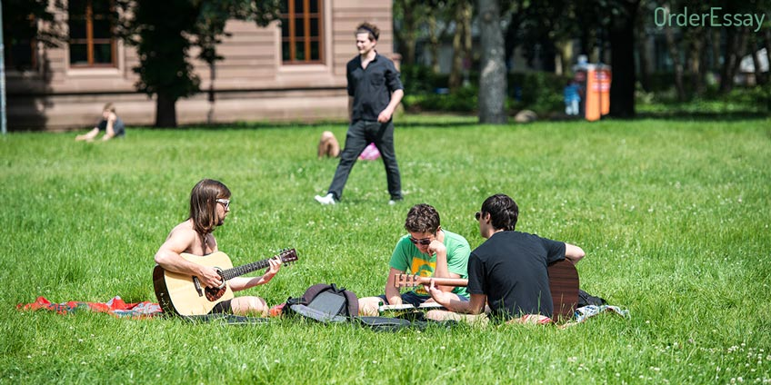 Students Playing Guitar in the Uni Yard